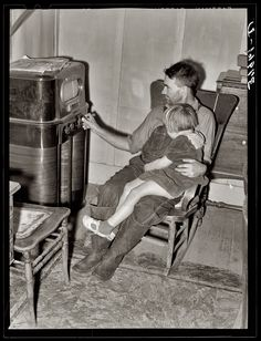 A Tehama Home Companion: November 1940. Tehama County, California. John Frost and his daughter listening to the radio in their home. Medium format safety negative by Russell Lee for the Farm Security Administration.