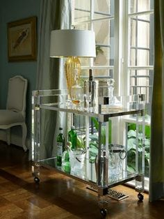 Designed by Jan Showers, an acrylic bar cart! Perfect for throwing parties, beautiful in the corner of your dining room, interesting as a cocktail table beside a chair...functional in so many ways and endlessly elegant and chic. Love it.