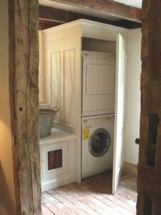 I am ALL for hiding the washer and dryer, no matter what they look like.  Easy access to what then looks much more civilized ninety-nine percent of the time is fabulous!
