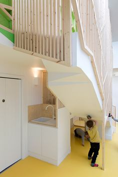 Lipton Plant adds indoor treehouse to nursery in Hackney House Slide, High Rise Building, Nursery School, Lipton, Stairway To Heaven, School Design, Architecture, Stairways, Colorful Interiors