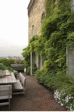 A New York penthouse garden that looks like it's in California or Oxfordshire. And that herringbone brick floor - amen. Outdoor Rooms, Outdoor Gardens, Outdoor Living, Rooftop Gardens, Rooftop Terrace, Terrace Garden, Green Terrace, Brick Patios, Modern Landscaping