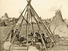 Oglala Lakota women and children sit inside the home of Mrs. American Horse, the wife of the Oglala chief who gained influence during the Great Sioux War of 1876-77, in this 1891 photo by John Grabill that was likely taken on or near the Pine Ridge Reservation in South Dakota.  – Courtesy Library of Congress –