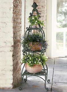 Add delicate charm to your outdoor space with the intricately detailed Florentine Plant Etagere; a beautiful setting for your favorite foliage.
