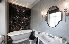 Black and white bathroom decor view in gallery silver wallpaper in the black and white bathroom Bathroom Accent Wall, Silver Bathroom, White Bathroom Decor, Bathroom Accents, Bathroom Black, Bathroom Ideas, Bathroom Wallpaper, Accent Walls, Black Bathtub