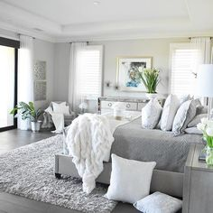"""Weekend vibes: when your longest commute is from the bed to the comfy chair"" Yes to this. We love this bedroom refresh from 👁 spy: new mirrored art, new pillows and a potted statement piece on the dresser! Small Master Bedroom, Master Bedroom Design, White Bedroom, Modern Bedroom, Romantic Master Bedroom, Bedroom Designs, Grey And White Bedding, Bedroom Classic, Grey Bedding"