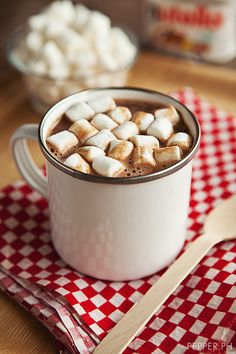 A big ol' mug of homemade hot chocolate topped with a mountain of fresh cream or mallows!