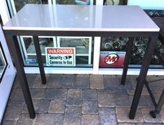 """Parsons Console by Room & Board has dark steel legs and white quartz composite stone top. Make it your kitchen island or bar. Made in USA. 36"""" x 18"""" x 35"""" tall."""