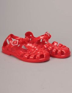 The bright red jelly shoes from Armani Baby have woven uppers with buckle fastening and white brand detail. Red Jelly, Armani Logo, Jelly Shoes, Red Logo, White Brand, Baby Shoes, Footwear, Logos, Sneakers