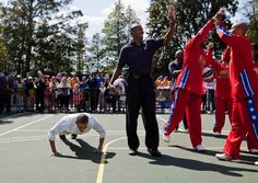 """President Barack Obama does push-ups on the White House Basketball Court after a member of the Harlem Globetrotters made a shot, April 9, 2012. The President participated in """"Shoot for Strength"""", a game where children did push-ups for every basketball shot made by the pros, during the 2012 White House Easter Egg Roll festivities."""