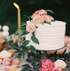 small wedding cake in pink and white
