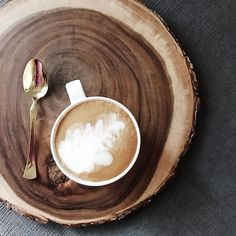My first B in my latte art studies.  // Tap for details. My gold flatware is from @homegoods as well as the giant wood coaster! Mug is from @starbucks. #sunday #coffee #makehomeyours