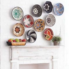 fireplace decorating with colorful wicker bowls