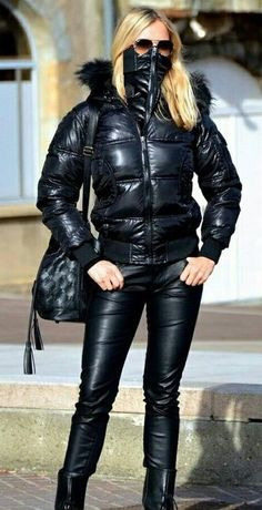 Blonde donning shiny Anorak with attached Mask and Leather Pants