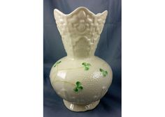 Belleek Shamrock Patterned Vase – 6″H    Another amazing work of art that you can proudly display on your homes!   Get this amazing ceramic decorative art for only $85.00! See our website for possible discounts! You won't find this nowadays!