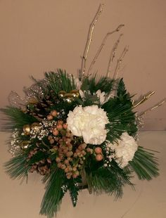 A quant winter greens arrangement.