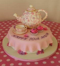 Teapot and teacup cake.  70th birthday cake with cupcakes, pink and purple