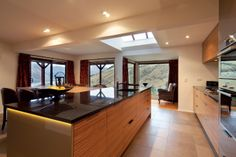 The view from the kitchen takes in the surrounding mountains and lake. This vista was the starting point for the design, which seeks to highlight rather than compete with the natural environment. Kitchen Interior, Highlight, Kitchens, Environment, Mountains, Natural, Table, Furniture, Design