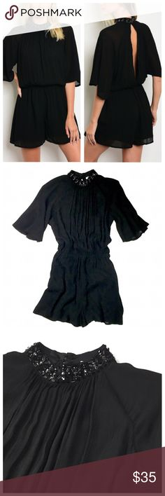 Black Embellished High Neck Romper Gorgeous black romper featuring loose 3/4 sleeves, draping detail, open back, and jeweled embellished neck detail. Pull on style with hook & eye closure at center back neck. Can be easily worn dressed up with heels, or worn with moto boots for a more casual chic vibe :) 100% Rayon. Nikibiki Pants Jumpsuits & Rompers