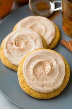 These autumn-inspired Pumpkin Sugar Cookies with Cinnamon Cream Cheese Frosting are sprinkled with yummy cinnamon.
