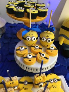 Chocolate covered Oreos and candy apples at a Minions birthday party! See more party planning ideas at CatchMyParty.com!