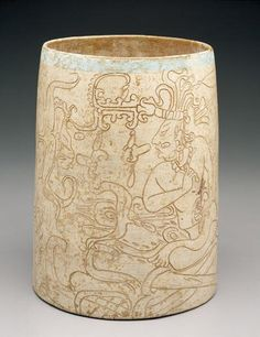Incised cylinder vessel depicting an enthroned lord and God K. Date: c. A.D. 600-900. Maya culture