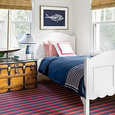 This nautical boy's room is filled with navy, red, and white, plus sea-inspired decor.