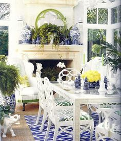 Ruthie Sommers  - a very elegant and classic blue and white room with Frances Elkins loop chairs