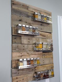 Most of us hide our mismatched spices in a cabinet until it's time to cook. Anthony Carrino and John Colaneri of HGTV's Kitchen Cousins have a solution to turn your spices into a unique piece of artwork. Slabs of reclaimed wood were cut to size and nailed to the wall, and then various metal holders were added to hold 30 different spices in matching canisters.