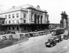 """~Union Station, Denver CO. c.1912-1920~ View of Union Station, in Denver, Colorado; shows cars, trucks, the """"Welcome Arch"""" and a streetcar"""