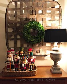 Mini Christmas Tour. tobacco basket with preserved boxwood wreath and nutcracker collection.