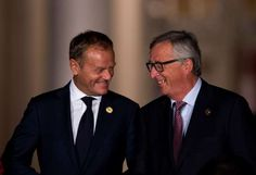 European Council President Donald Tusk (L) talks with President of the European Commission Jean-Claude Juncker as they walk across the ground for a group picture prior to a dinner banquet at the G20 Summit in Hangzhou
