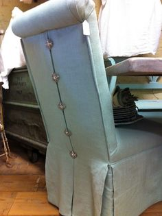 upholstered parsons chair with dressmaker rhinestone buttoned detailed back