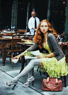 "Lily Cole reading The New Yorker. ""New York Doll."" Photo by Arthur Elgort for British Vogue, January 2008. ""For lunch at the Gemma Café, school knits add studious charm to Versace's chiffon ensemble. Belted silk-chiffon dress, $2,450."""