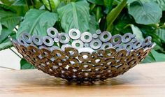 Decorative bowl made from washers & scrap metal.  Now if only I had a soldering gun...
