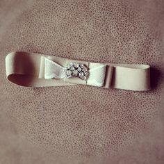 Bridal Garter: 1960's Swarovski Crystal Crown Jewelry Piece, Vintage Lace, & Straw Petersham Ribbon. $42.00, via Etsy.
