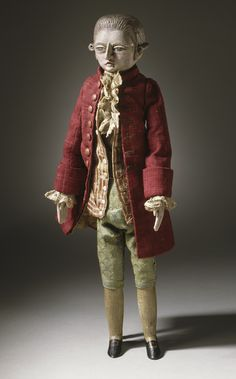 Male Court Doll France, circa 1780 Sculpture a) Carved and painted wood; b-c) Silk and linen a) Doll: 14 x 4 1/2 x 2 1/4 in.