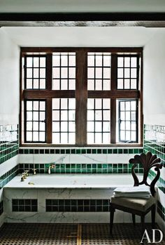 A bath in the Edwin Lutyens–designed Hampshire, England, estate Marshcourt, with an expansive leaded window | archdigest.com