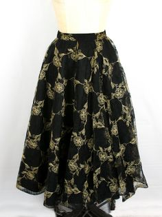 This Vintage 1950's Sport and Whirl Black and Gold Skirt is incredible!