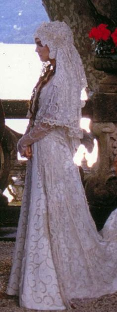 http://videos.vidora.com/details?v=1626 Padme Amidala (Natalie Portman) wore this whimsical wedding dress in 'Star Wars II'!  Costume designer Trisha Biggar conceived this dress and tackled being otherworldly and chic - a perfect example of film fashion artistry!