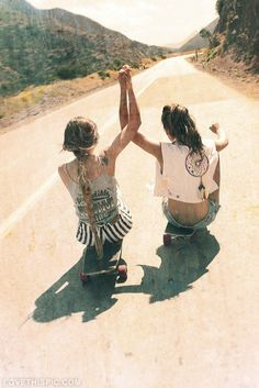 rolling down the road girly photography blonde cool girls brunette holding hands skateboards