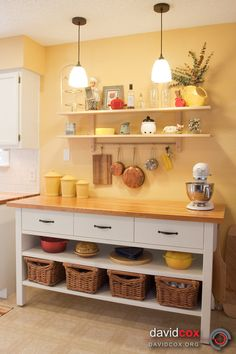 Open Shelving. Hanging bar for pans. Kitchen counter/island for extra storage and counter space.