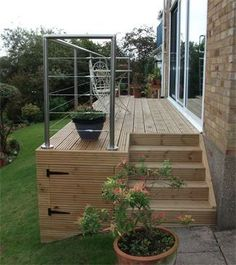 Contemporary modern decking with wooden steps and stainless steel hand rail designed and installed by cambridge fencing and decking. Back Garden Design, Fence Design, Back Gardens, Outdoor Gardens, Steel Handrail, Patio Deck Designs, Raised Patio, Wooden Terrace, Modern Contemporary