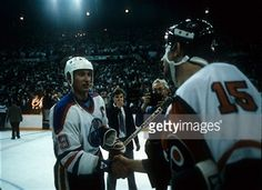 Rich, shaking hands with Wayne Gretzky.