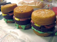 """Slider cakes - cake """"buns"""" and brownie """"burger"""".  Buttercream icing for the lettuce, ketchup, mustard."""