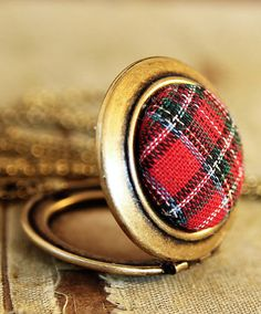 Vintage red plaid and gold locket.