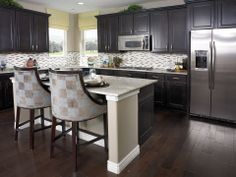 The breakfast bar seating makes this kitchen more inviting. The Skylar plan, available in CO & UT.