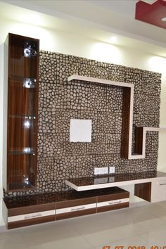 Real Pebbles used on wall for TV Unit background. Lcd Unit Design, Lcd Wall Design, Modern Tv Unit Designs, Tv Unit Interior Design, Tv Unit Furniture Design, Wall Unit Designs, Modern Tv Wall Units, Living Room Tv Unit Designs, Bedroom Tv Unit Design