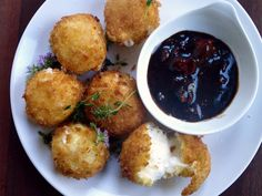 Cheese Fritters with Balsamic Sun Dried Tomato Dipping Sauce - Evil Chef Mom (Super Bowl Tailgate Lunch Vegetarian Wheat Dairy Vegetables Fruit Gluten Egg products Animal products Superbowl Tailgating Appetizer / sides Salt Ricotta cheese Black pepper Thyme Dijon mustard Flour Panko Vegetable oil Balsamic vinegar Mozzarella cheese Sundried tomatoes Eggs Lemons Olive oil)