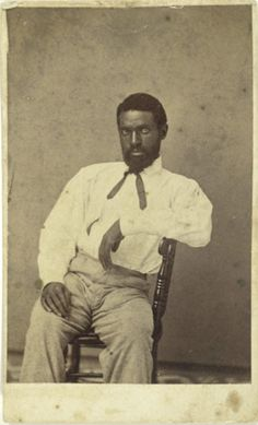 """ca. 1860-70's, [carte de visite portrait of a casually posed gentleman, escaped from slavery. Inscription on verso reads """"Lewis, who came from the south with Langhorn 1863""""], D. Hinkle    via Cowan's Auctions"""