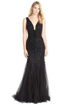 Free shipping and returns on Jovani Beaded Mesh Mermaid Gown at Nordstrom.com. A super-subtle illusion inlay keeps this gown's plunging neckline secure so you can comfortably focus on wowing the crowd. The scrolling beadwork glimmers throughout the figure-flaunting bodice before fading into the sweeping godet-flounced skirt.